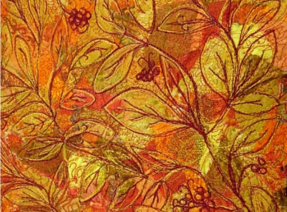 free-motion embroidery showing autumn leaves and berries