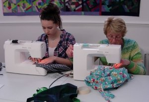 Sophie having a sewing lesson along with her Gran. You're never too young – or too old – to learn to sew