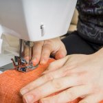 Improve your dressmaking - someone sewing a straight neat seam