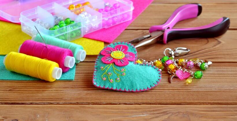 Hand embroidery. A kids sewing class to make a felt heart keychain