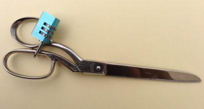 Sewing Bad Habits to avoid. Dressmaking shears with a padlock to stop them being used on substances other than fabric.