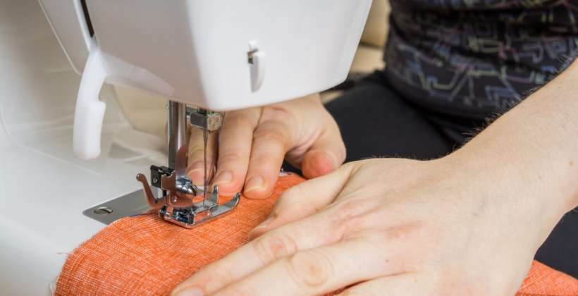 beginners sewing day - a student learn how to use a sewing machine